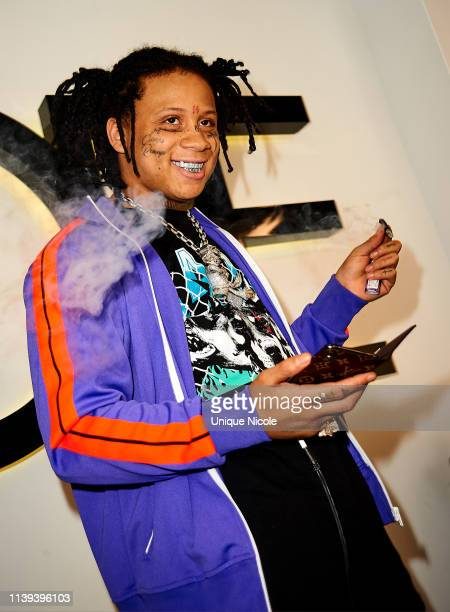 Trippie Redd performs for fans at Launch Event of Rapper Trippie Redd's Clothing Line With DOPE at DOPE on March 30 2019 in Los Angeles California