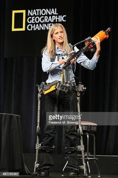 Trish Aelker demonstrates the FORTIS exoskeleton onstage during the 'Breakthrough' panel discussion at the National Geographic Channel portion of the...