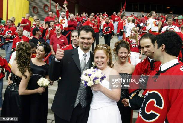 Trish and Domenic Staffa of Calgary celebrate after being married outside the Pengrowth Saddledome before the start of game six of the NHL Stanley...