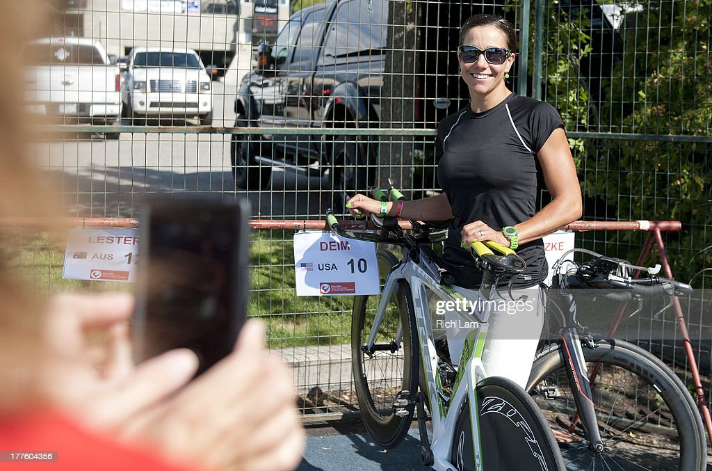 Trish Deim of the United States poses for a photo with her bike during the Challenge Penticton Triathlon previews on August 24, 2013 in Penticton, British Columbia, Canada.