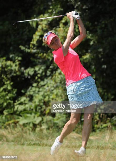 Trish Johnson of England plays a tee shot on the eighth hole during the final round of the US Senior Women's Open at Chicago Golf Club on July 15...
