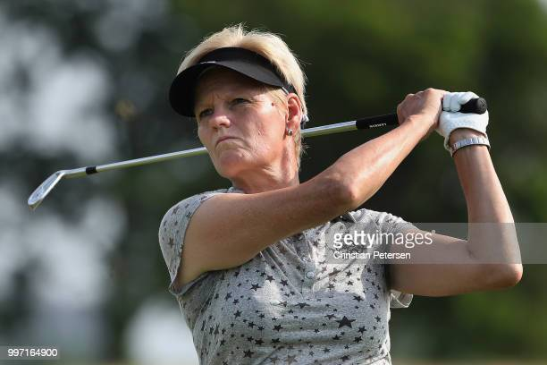 Trish Johnson of England plays a tee shot on the seventh hole during the first round of the US Senior Women's Open at Chicago Golf Club on July 12...