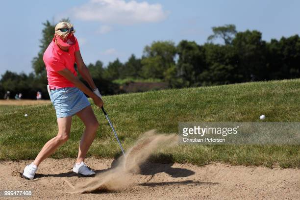 Trish Johnson of England plays from the bunker on the fourth hole during the final round of the US Senior Women's Open at Chicago Golf Club on July...