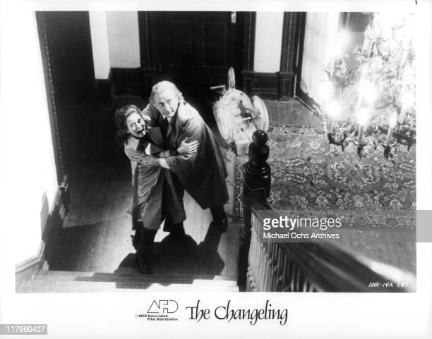 Trish Van Devere clings to George C Scott in a scene from the film 'The Changeling' 1980
