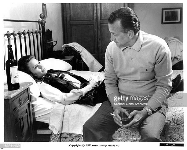 Trish Van Devere lies in bed with George C Scott in a scene from the film 'The Last Run' 1971