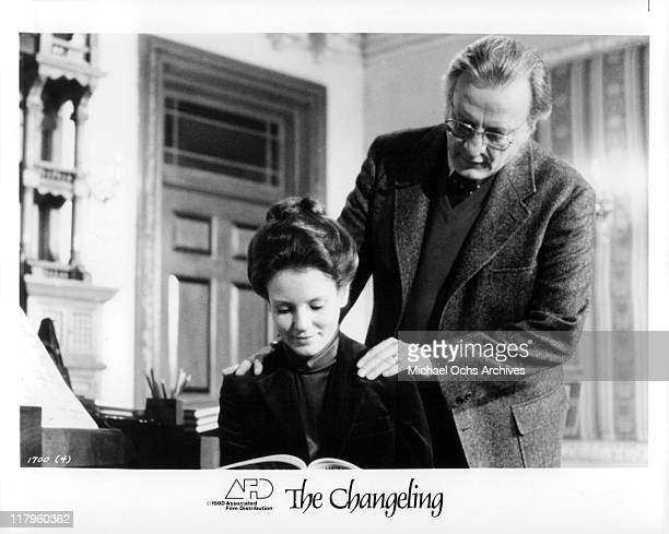 Trish Van Devere researches with George C Scott about the history of the old Victorian Mansion in a scene from the film 'The Changeling' 1980