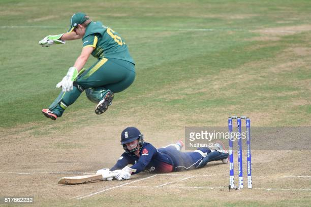 Trisha Chetty of South Africa jumps over Sarah Taylor of England while she slides back into her crease during the SemiFinal ICC Women's World Cup...