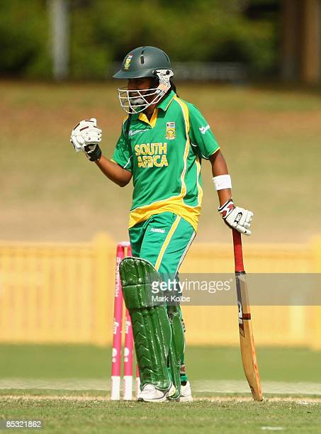 Trisha Ghetty of South Africa celebrates scoring a half century during the ICC Women's World Cup 2009 round two group stage match between Australia...