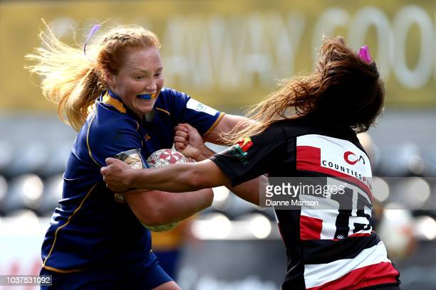 Trisha Hopcroft of Otago fends off Waikohika Flesher of Counties Manukau during the round four Farah Palmer Cup match between Otago and Counties...