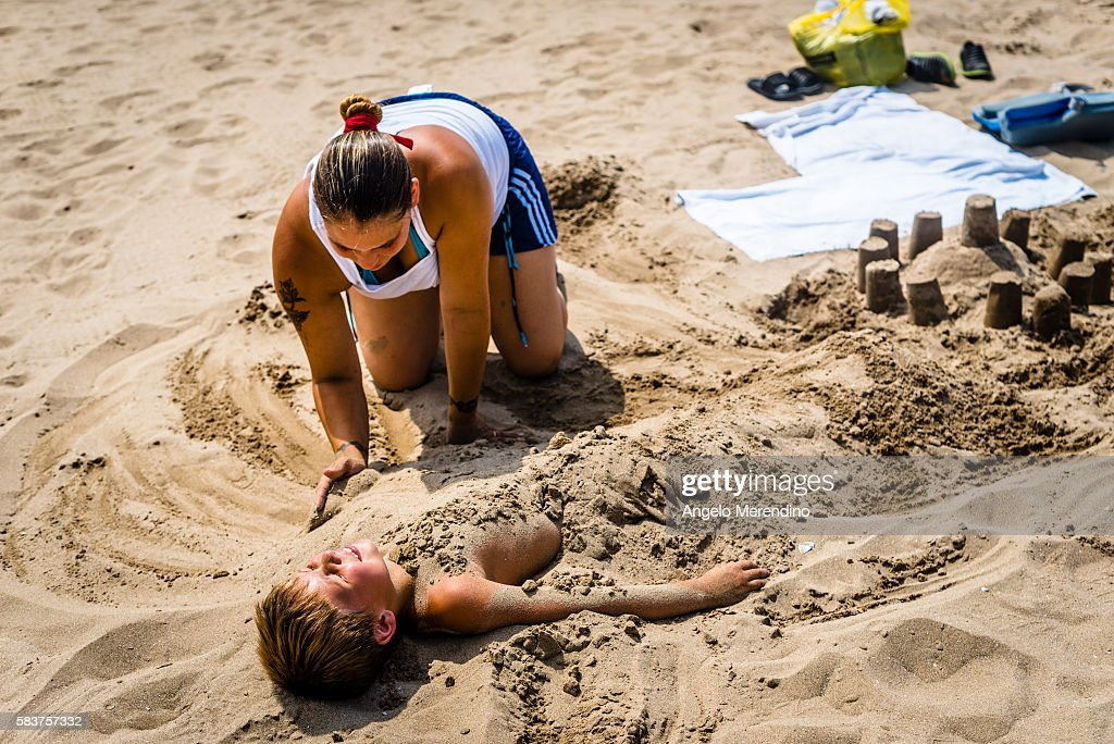 Mom Buries Her Son In The Sand News Photo