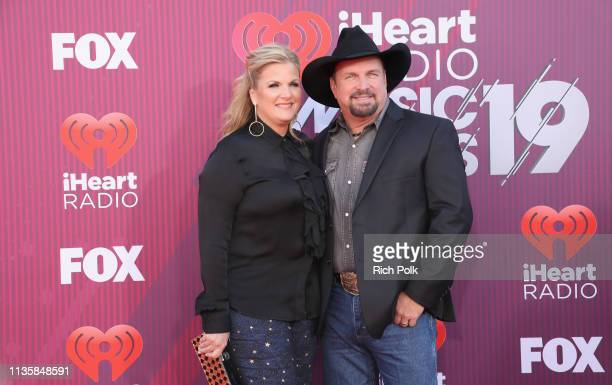Trisha Yearwood and Garth Brooks attend the 2019 iHeartRadio Music Awards which broadcasted live on FOX at Microsoft Theater on March 14 2019 in Los...