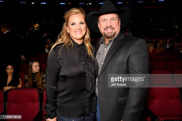 Trisha Yearwood and Garth Brooks attend the 2019 iHeartRadio Music Awards which broadcasted live on FOX at the Microsoft Theater on March 14 2019 in...