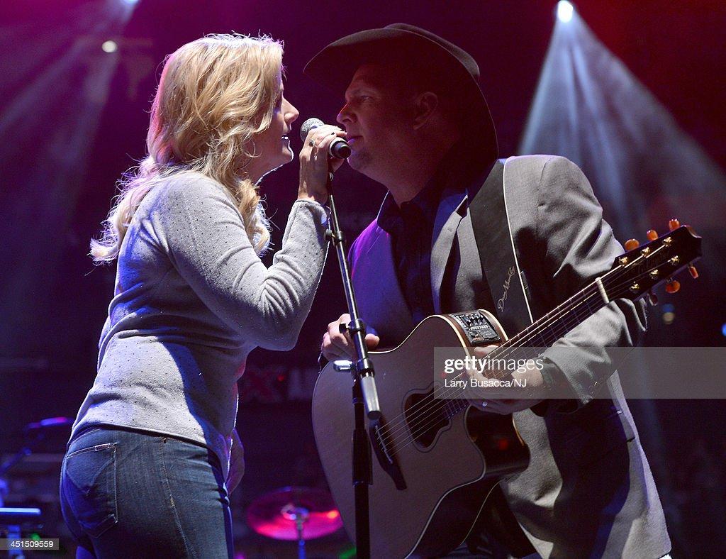 Trisha Yearwood and Garth Brooks perform during Playin' Possum! The Final No Show Tribute To George Jones - Show at Bridgestone Arena on November 22, 2013 in Nashville, Tennessee.