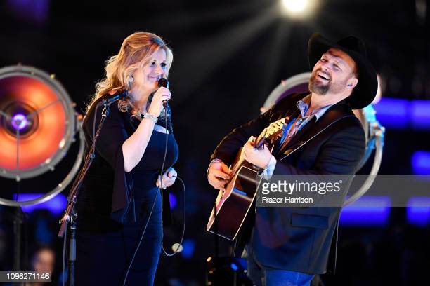 Trisha Yearwood and Garth Brooks perform onstage during MusiCares Person of the Year honoring Dolly Parton at Los Angeles Convention Center on...