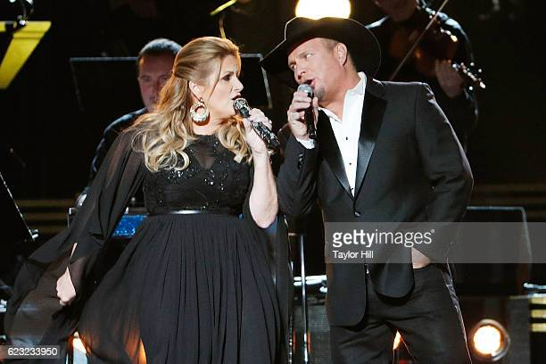 Trisha Yearwood and Garth Brooks perform onstage during the 50th annual CMA Awards at the Bridgestone Arena on November 2 2016 in Nashville Tennessee