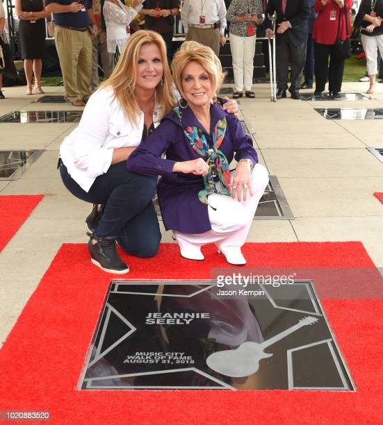 Trisha Yearwood and Jeannie Seely attend the 2018 Music City Walk Induction Ceremony at Walk of Fame Park on August 21 2018 in Nashville Tennessee