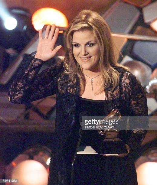 Trisha Yearwood holds her Grammy after winning in the Female Country Vocal Category for her hit song 'How Do I Live'' during the 40th Grammy Awards...
