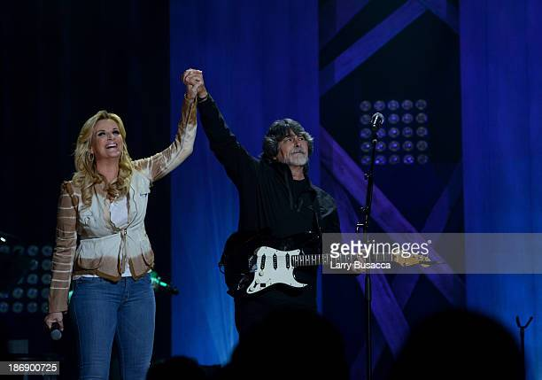 Trisha Yearwood performs with Randy Owen of Alabama at the Ryman Auditorium on November 4, 2013 in Nashville, Tennessee.