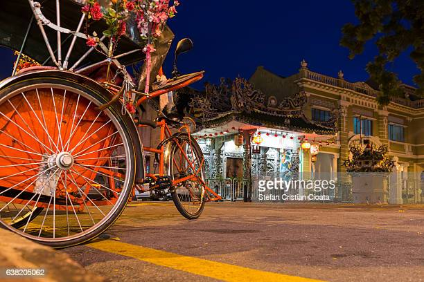 trishaw ride in penang - george town penang stock photos and pictures