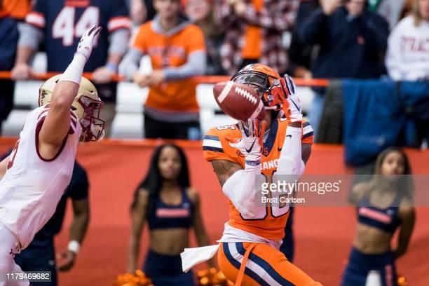 Trishton Jackson of the Syracuse Orange makes a touchdown reception as Nolan Borgersen of the Boston College Eagles defends during the first quarter...