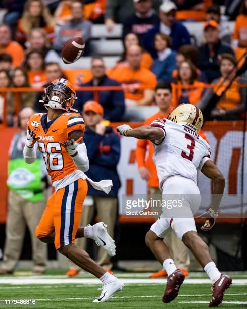 Trishton Jackson of the Syracuse Orange makes a touchdown reception against Jason Maitre of the Boston College Eagles during the third quarter at the...