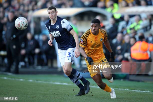 Tristan Abrahams of Newport County and Murray Wallace of Millwall chase the ball during the FA Cup Third Round match between Millwall FC and Newport...