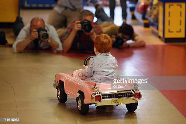 Tristan aged 2 is photographed as he rides a 'Hollywood Pedal Car' in Hamleys toy shop on June 27 2013 in London England The car which retails for...