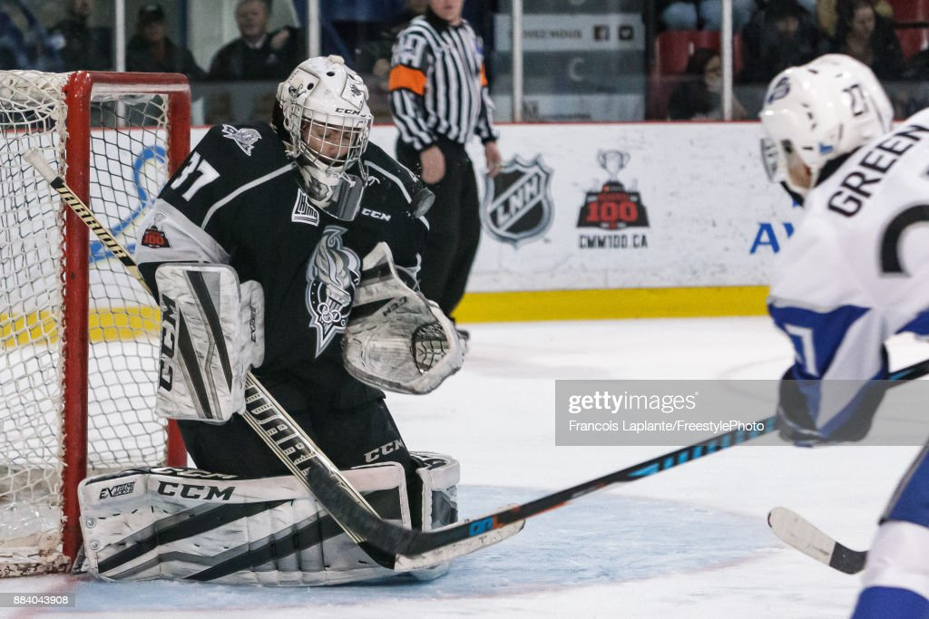 Tristan Berube #37 of the Gatineau Olympiques makes a save against Matt Green #27 of the Saint John Sea Dogs on December 1, 2017 at Robert Guertin Arena in Gatineau, Quebec, Canada.