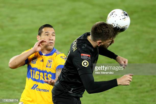 Tristan Blackmon of Los Angeles FC heads the ball in front of Luis Rodriguez of Tigres UANL during the CONCACAF Champions League final game at...