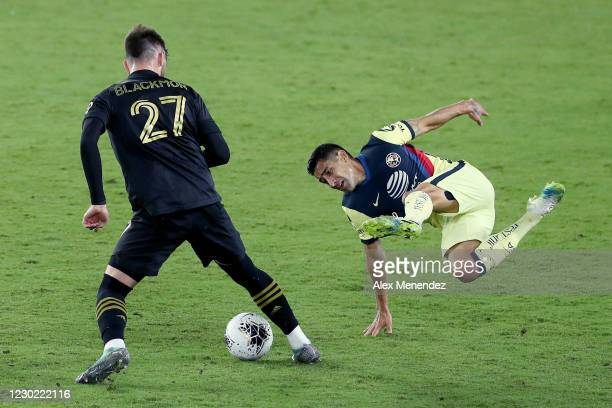 Tristan Blackmon of Los Angeles FC trips Luis Fuentes of Club America during the CONCACAF Champions League semifinal game at Exploria Stadium on...