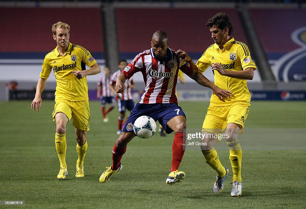 Tristan Bowen #7 of Chivas USA is defended by Tyson Wahl (L) #2 and Glauber #4 of Columbus Crew in the second half at The Home Depot Center on March 2, 2013 in Carson, California. The Crew defeated Chivas USA