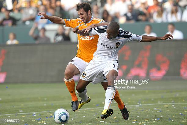 Tristan Bowen of the Los Angeles Galaxy battles for the ball with Brian Mullan of the Houston Dynamo on June 5 2010 at the Home Depot Center in...