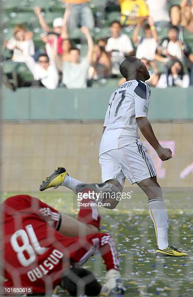 Tristan Bowen of the Los Angeles Galaxy celebrates after getting the Galaxy's third goal past goalkeeper Pat Onstad of the Houston Dynamo on June 5...