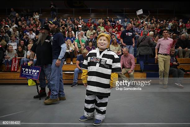 Tristan Clancy of South Saint Paul Minnesota dresses as Democratic presidential nominee Hillary Clinton in prison garb while attending a rally for...