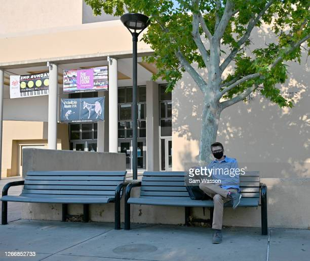 Tristan Coger, a freshman, sits on a bench as students begin classes amid the coronavirus pandemic on the first day of the fall 2020 semester at the...