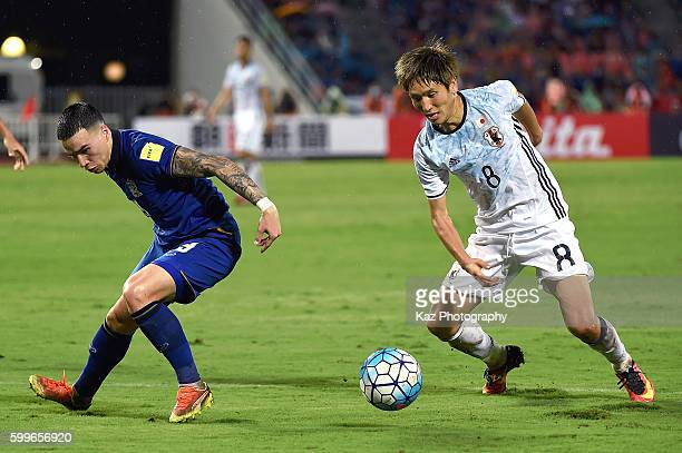 Tristan Do of Thailand competes for ball against Genki Haraguchi of Japan during the 2018 FIFA World Cup Qualifier between Thailand and Japan at the...