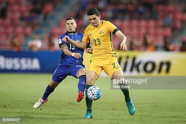 Tristan Do of Thailand and Tomas Rogic of the Socceroos compete for the ball during the 2018 FIFA World Cup Qualifier match between Thailand and the...