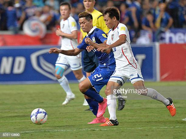 Tristan Do of Thailand fights for the ball with Huang Kaichun of Taiwan during their 2018 FIFA World Cup Qualifier asian group F match at Rajamangala...