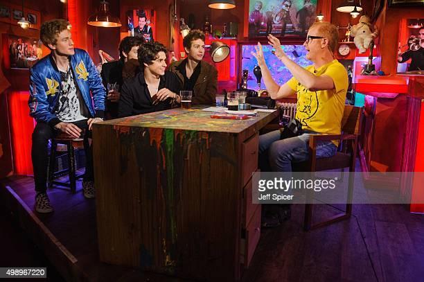 Tristan Evans Connor Ball Brad Simpson James Daniel McVey Chris Evans during a live broadcast of 'TFI Friday' on November 27 2015 in London England