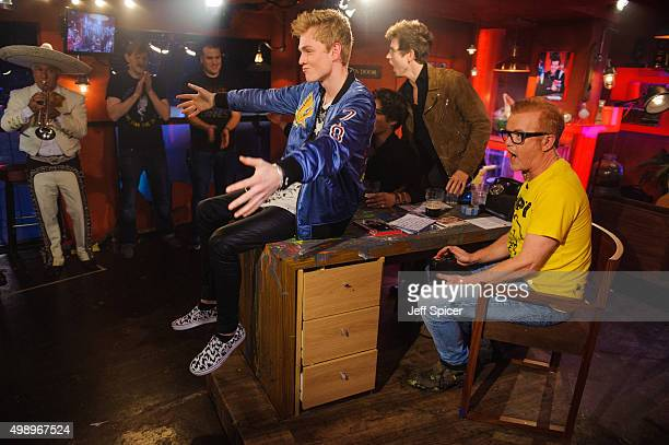 Tristan Evans James Daniel McVey and Chris Evans during a live broadcast of 'TFI Friday' on November 27 2015 in London England