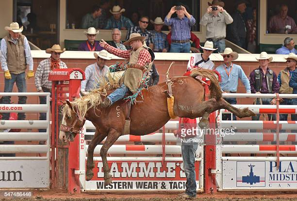 Tristan Hansen from Victor ID on Yacht Hijacker during Novice Bareback competition at the Calgary Stampede 2016 Twenty of the world's top competitors...