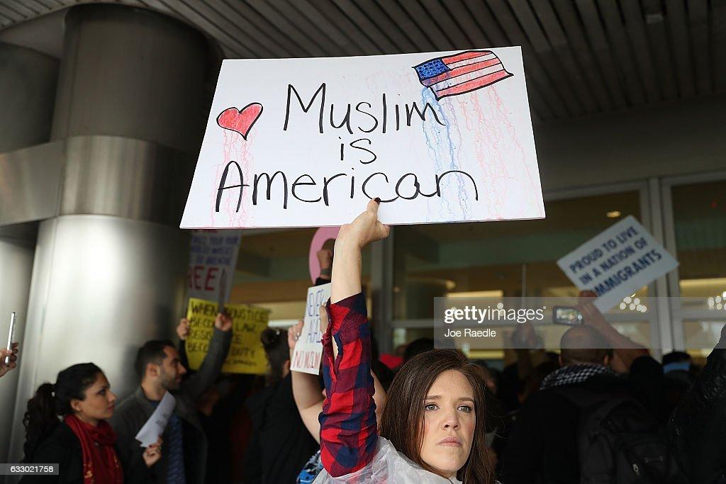 Protestors Rally Against Muslim Immigration Ban At Miami Airport : News Photo