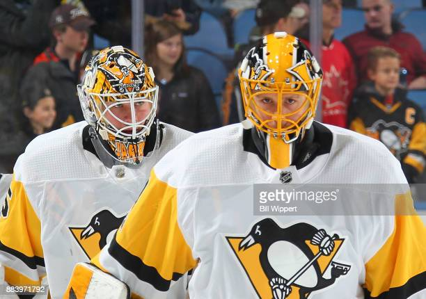 Tristan Jarry and Casey DeSmith of the Pittsburgh Penguins warm up before an NHL game against the Buffalo Sabres on December 1 2017 at KeyBank Center...