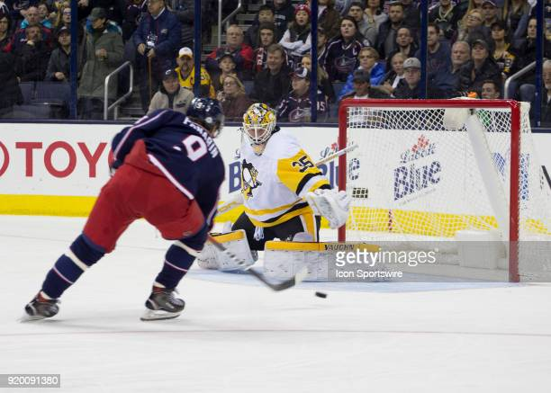 Tristan Jarry of the Pittsburgh Penguins attempts to block a shot from Artemi Panarin of the Columbus Blue Jackets during first period of the game...