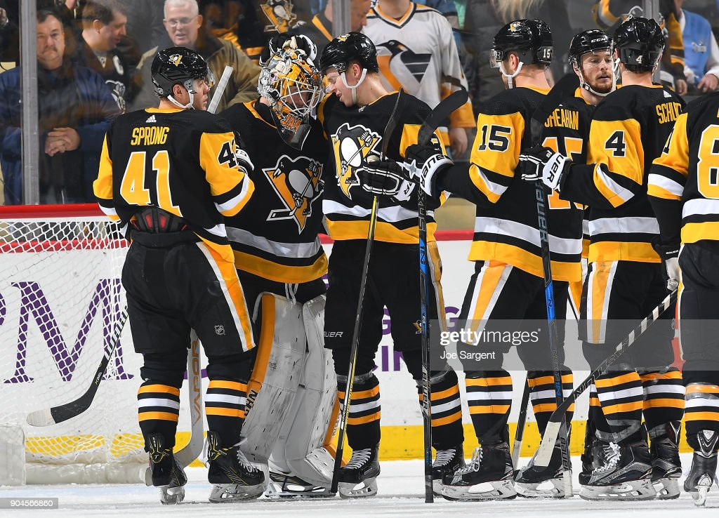 Tristan Jarry #35 of the Pittsburgh Penguins celebrates after defeating the Detroit Red Wings at PPG Paints Arena on January 13, 2018 in Pittsburgh, Pennsylvania.