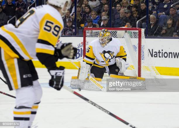 Tristan Jarry of the Pittsburgh Penguins deflects a shot with his pad during first period of the game between the Columbus Blue Jackets and the...