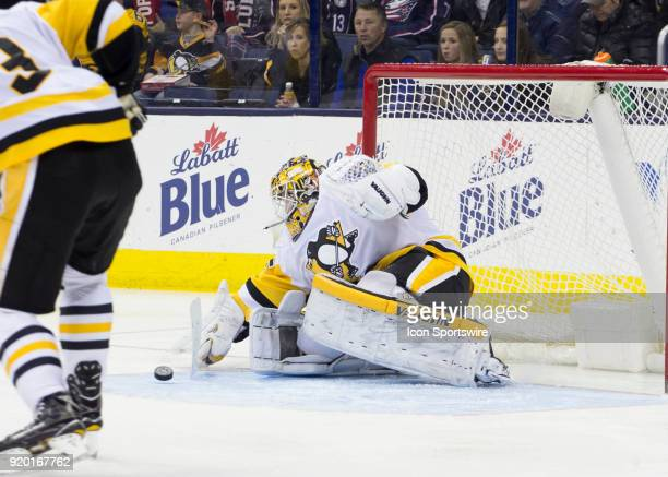 Tristan Jarry of the Pittsburgh Penguins deflects the puck during third period of the game between the Columbus Blue Jackets and the Pittsburgh...