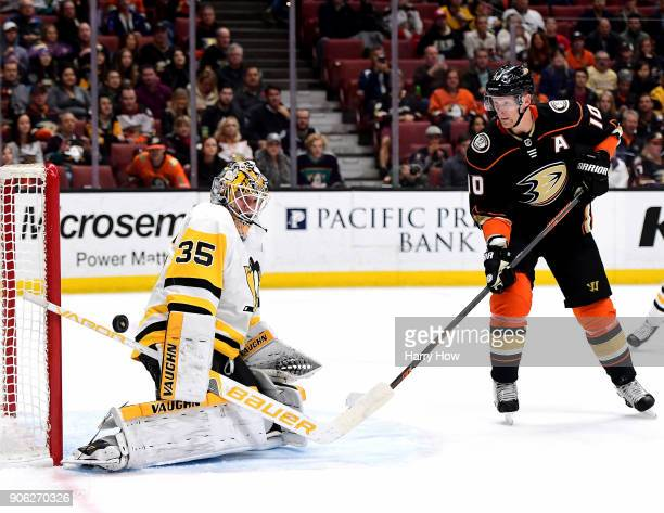 Tristan Jarry of the Pittsburgh Penguins makes a save as Corey Perry of the Anaheim Ducks looks for a rebound during the first period at Honda Center...