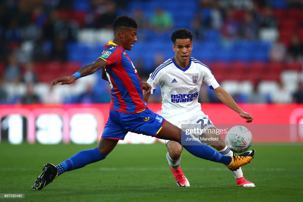 Tristan Nydam of Ipswich puts pressure on Patrick van Aanholt of Crystal Palace during the Carabao Cup Second Round match between Crystal Palace and Ipswich Town at Selhurst Park on August 22, 2017 in London, England.