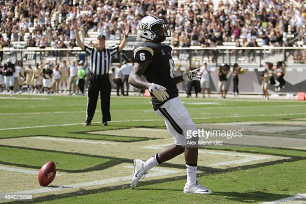 Tristan Payton of the UCF Knights crosses the goal line for a touchdown during an NCAA football game between the Houston Cougars and the UCF Knights...